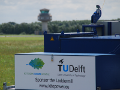 The 20kW ground station of the TU Delft with the tower of Valkenburg airfield in the background